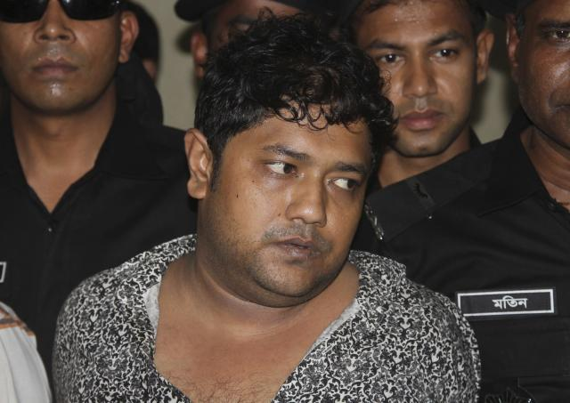 Mohammed Sohel Rana, the fugitive owner of an illegally-constructed building that collapsed last week in Bangladesh, killing some 377 people, is paraded by Rapid Action Battalion commandoes for the media along with unidentified alleged accomplices, not pictured, in Dhaka, Bangladesh, Sunday, April 28, 2013. Rana was arrested near the land border in Benapole in western Bangladesh, just as he was about to flee into India's West Bengal state, said Jahangir Kabir Nanak, junior minister for local government. (AP Photo/Palash Khan)