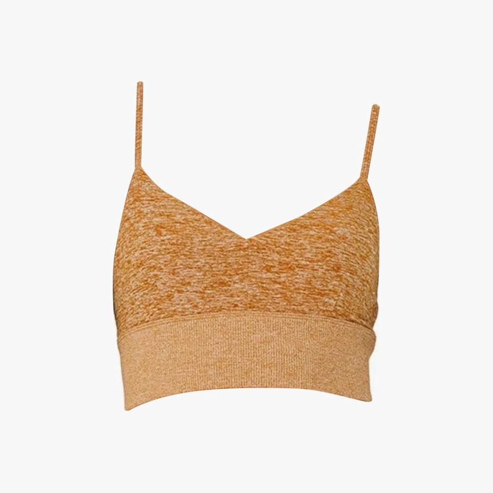 """Alo Yoga is offering up to 50% off this Memorial Day. $54, ALO YOGA. <a href=""""https://www.aloyoga.com/products/w9234r-alosoft-lavish-bra-bronze-heather"""" rel=""""nofollow noopener"""" target=""""_blank"""" data-ylk=""""slk:Get it now!"""" class=""""link rapid-noclick-resp"""">Get it now!</a>"""