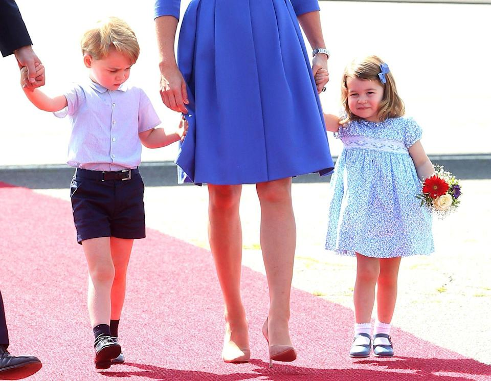 <p>The royal tots walk the red carpet with the Duke and Duchess of Cambridge after arriving in Berlin.</p>