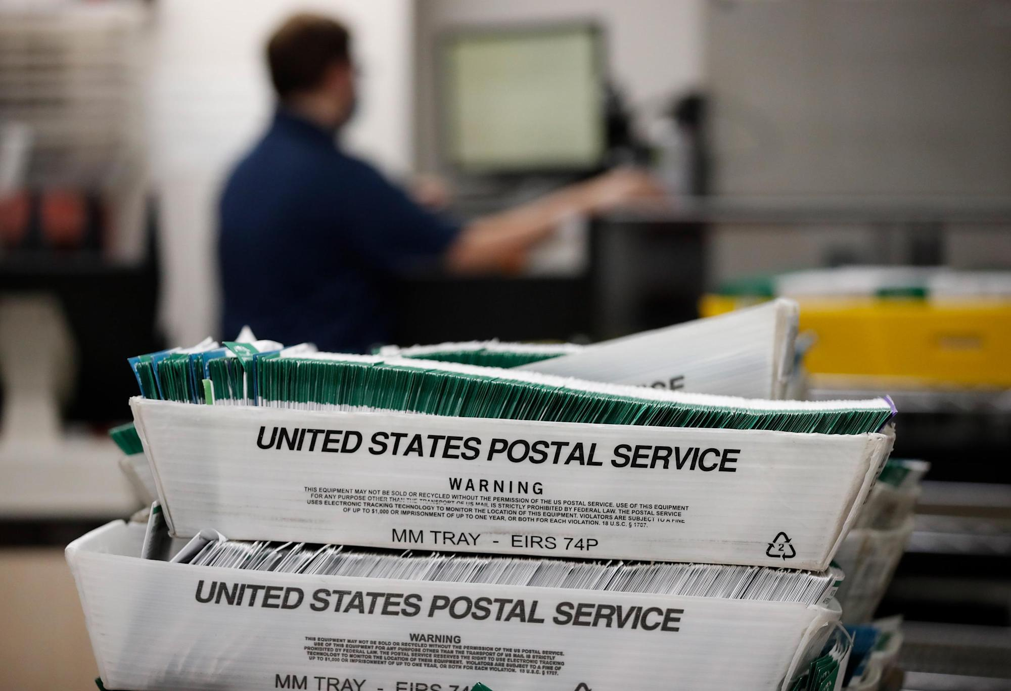 Ex-Postal Service worker charged with tossing absentee ballots in dumpster