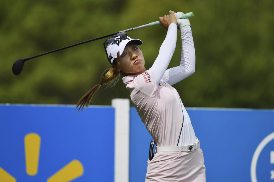Lydia Ko, of New Zealand, watches her drive off the 13th tee during the first round of the LPGA Walmart NW Arkansas Championship golf tournament, Friday, Sept. 24, 2021, in Rogers, Ark. (AP Photo/Michael Woods)