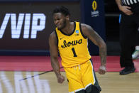Iowa guard Joe Toussaint (1) reacts to a basket against Oregon during the first half of a men's college basketball game in the second round of the NCAA tournament at Bankers Life Fieldhouse in Indianapolis, Monday, March 22, 2021. (AP Photo/Paul Sancya)