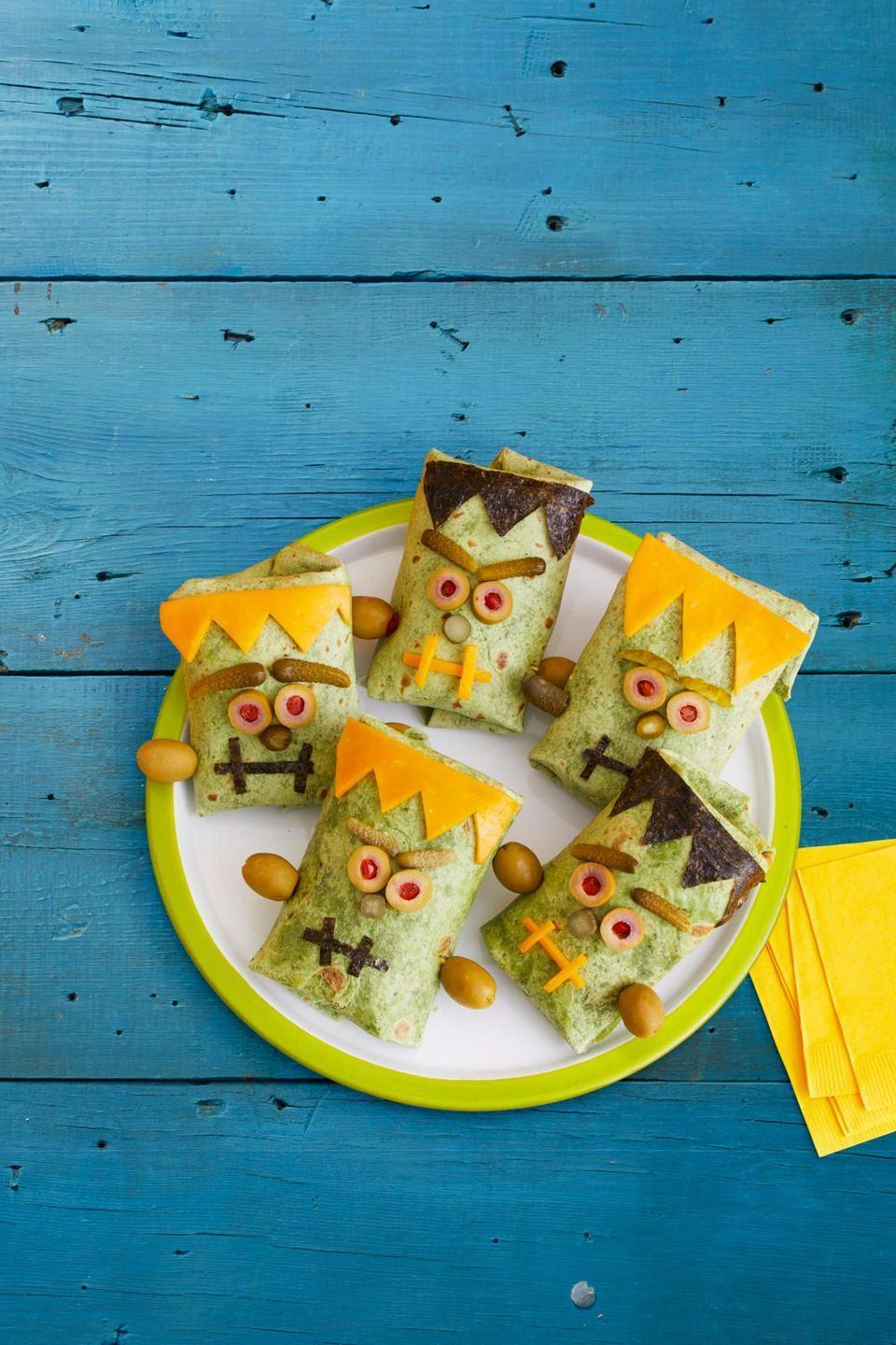 """<p>Your dinner with be a graveyard smash with these tasty bites. And they are completely customizable, so even picky eaters will be pleased. </p><p><strong><em><a href=""""https://www.womansday.com/food-recipes/a33564111/monster-wraps-recipe/"""" rel=""""nofollow noopener"""" target=""""_blank"""" data-ylk=""""slk:Get the Monster Wraps recipe."""" class=""""link rapid-noclick-resp"""">Get the Monster Wraps recipe.</a></em></strong></p>"""