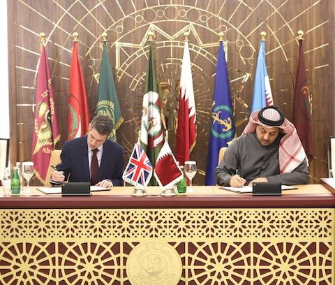 Defence Secretary Gavin Williamson and Minister of State for Defense of Qatar Khalid bin Mohammad Al Attiyah sign an agreement on the sale of Typhoon - Credit: Anadoulo