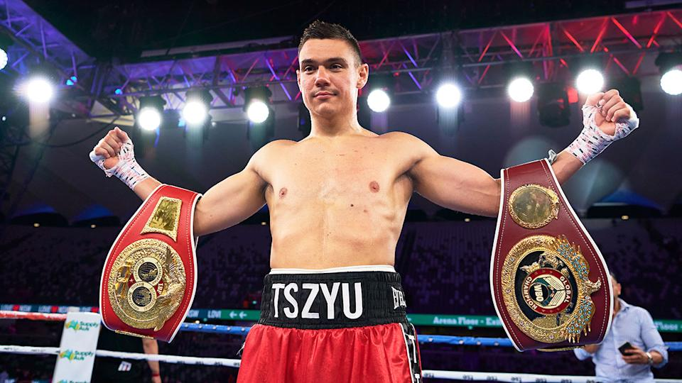 Seen here, Tim Tszyu holds his belts up after a big win on Wednesday night.