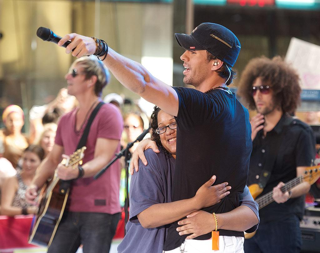 """The Latin heartthrob made one fan's day when he plucked her out of the crowd and serenaded her with """"Hero."""" If that wasn't enough, Melissa Dominguez, who hails from The Bronx, got the surprise of her life when Enrique planted a kiss on her lips! When asked how she was feeling, Melissa responded: """"It was nice … it was hot. I'm thinking dirty thoughts."""" K/<a href=""""http://www.splashnewsonline.com/"""" target=""""new"""">Splash News</a> - July 16, 2010"""