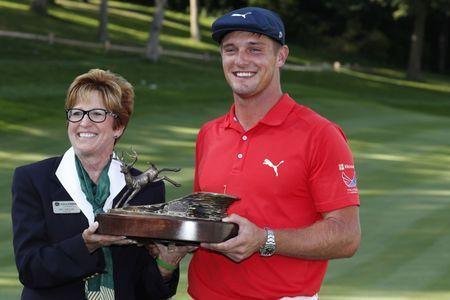 Jul 16, 2017; Silvis, IL, USA; Bryson DeChambeau poses with the trophy and tournament chairman Pat Shouse after winning the John Deere Classic golf tournament at TPC Deere Run. Brian Spurlock-USA TODAY Sports