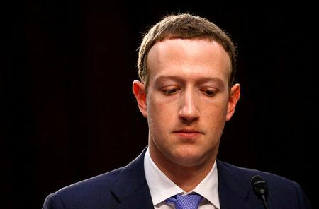 FILE PHOTO: Facebook CEO Mark Zuckerberg listens while testifying before a joint Senate Judiciary and Commerce Committees hearing regarding the company's use and protection of user data, on Capitol Hill in Washington, U.S., April 10, 2018. REUTERS/Leah Millis/File Photo