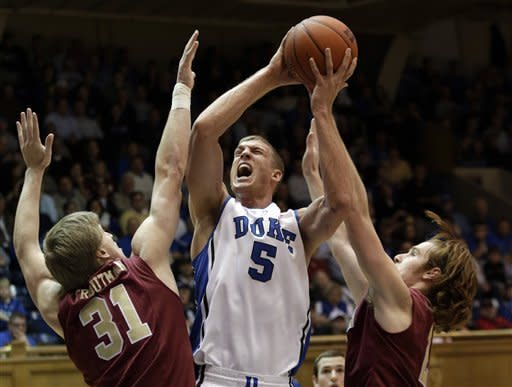 Duke's Mason Plumlee (5) shoots while Elon's Lucas Troutman (31) and Ryley Beaumont defend during the first half of an NCAA college basketball game in Durham, N.C., Thursday, Dec. 20, 2012. (AP Photo/Gerry Broome)