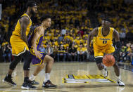 Virginia Commonwealth guard De'Riante Jenkins (0) drives around LSU guard Skylar Mays (4) during the first half of an NCAA college basketball game in Richmond, Va., Wednesday, Nov. 13, 2019. (AP Photo/Zach Gibson)