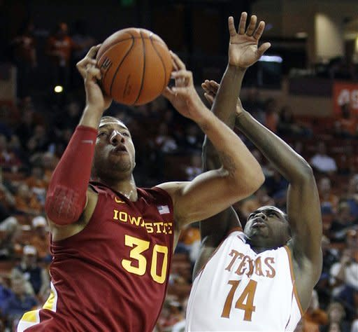 Iowa State's Royce White (30) is defended by Texas' J'Covan Brown (14) during the first half of an NCAA college basketball game, Tuesday, Jan. 24, 2012, in Austin, Texas. (AP Photo/Eric Gay)