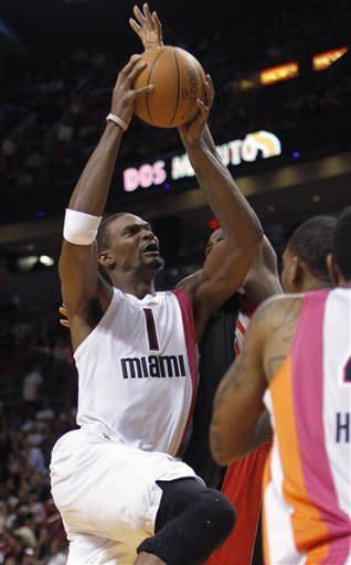 Miami Heat's Chris Bosh (1) goes to the basket against the Toronto Raptors in the first half of an NBA basketball game in Miami, Sunday, Feb. 5, 2012. (AP Photo/Alan Diaz)