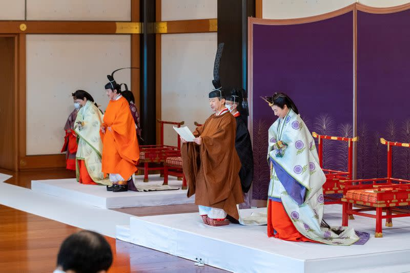 Handout photo shows Japan's Crown Prince Akishino and Crown Princess Kiko, attend a ceremony for formally proclaims Crown Prince Akishino is the first in line as heir to the throne, in Tokyo