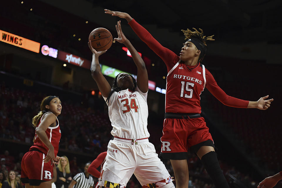 Rutgers Caitlin Jenkins, right, is suspended indefinitely after a weekend arrest. (AP Photo/Gail Burton)