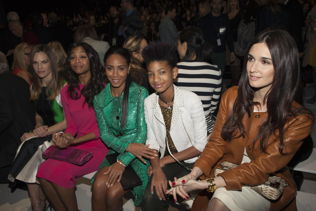 (L-R) Hilary Swank, Zoe Saldana, Jada Pinkett Smith, Willow Smith and Paz Vega attend the Michael Kors Autumn/Winter 2013 collection during New York Fashion Week February 13, 2013. REUTERS/Andrew Kelly (UNITED STATES - Tags: FASHION ENTERTAINMENT) - RTR3DR13