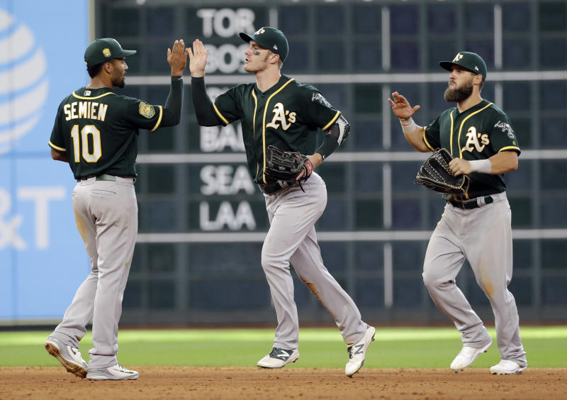Canha's two-run single helps A's rally past Astros 6-4