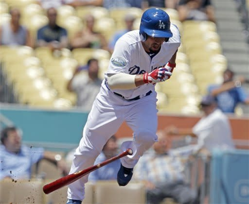 Los Angeles Dodgers' Shane Victorino, recently acquired from the Philadelphia Phillies, leaves the batter's box on a ground-out in the first inning of a baseball game against the Arizona Diamondbacks in Los Angeles on Wednesday, Aug. 1, 2012. (AP Photo/Reed Saxon)