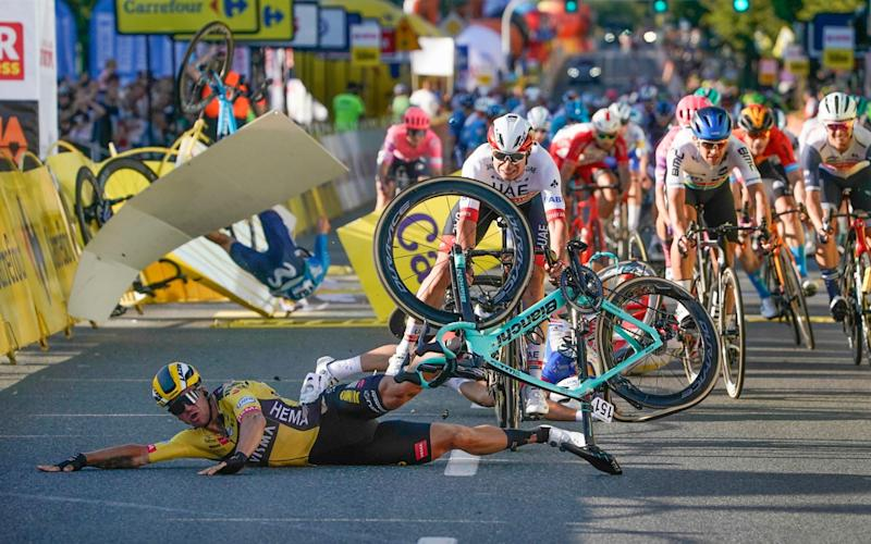 Dutch cyclist Dylan Groenewegen crashes to the ground as a bicycle is flying overhead in a major collision on the final stretch of the opening stage of the Tour de Pologne race -Fabio Jakobsen in an induced coma after a horrific crash during Tour of Poland first stage - AP