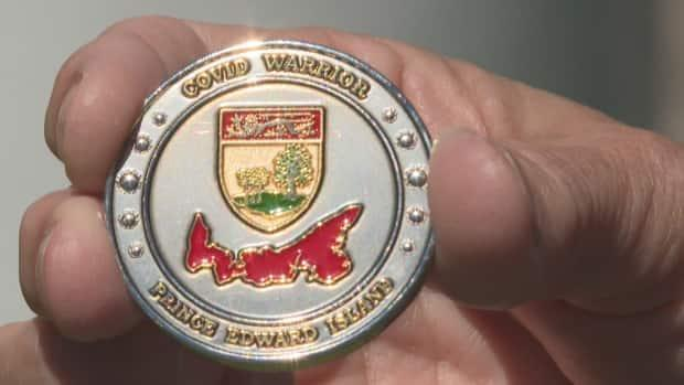 The COVID Warrior Coin recognizes Islanders who helped their communities during the pandemic.  (Danny Arsenault/CBC - image credit)
