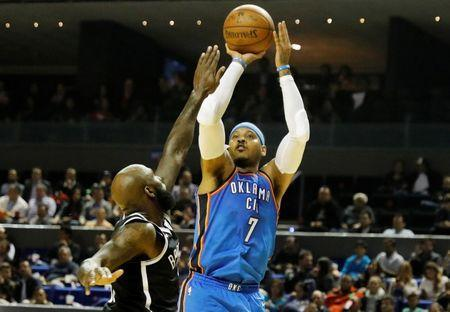 Basketball - NBA Global Games - Brooklyn Nets v Oklahoma City Thunder - Arena Mexico, Mexico City, Mexico December 7, 2017. Quincy Act of Brooklyn Nets and Carmelo Anthony of Oklahoma City Thunder in action. REUTERS/Carlos Jasso