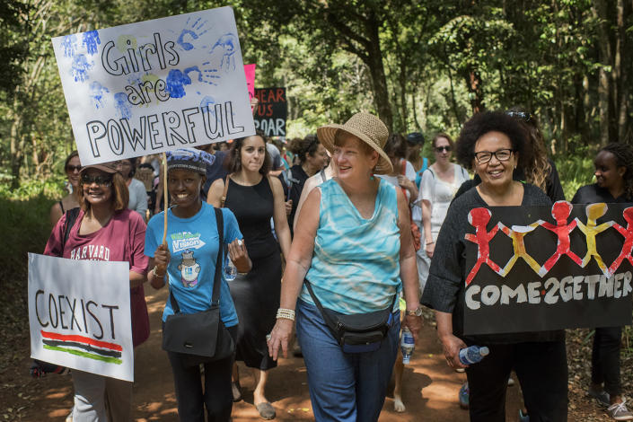 "<p>From left, Mariannique Gachecheh, Ann Wambui, Renate Lotay and Amina Litondo participate in the Nairobi Women's March in Karura Forest, Kenya, on Jan. 21. ""I think things are going to slide backwards and we need to stand up,"" Lotay said. (Photo: Christena Dowsett for Yahoo News) </p>"