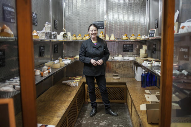 Katherine McLaughlin in her cheese shop in the Gothic Quarter of Barcelona Dec. 19. (Photo: Jose Colon/MeMo for Yahoo News)