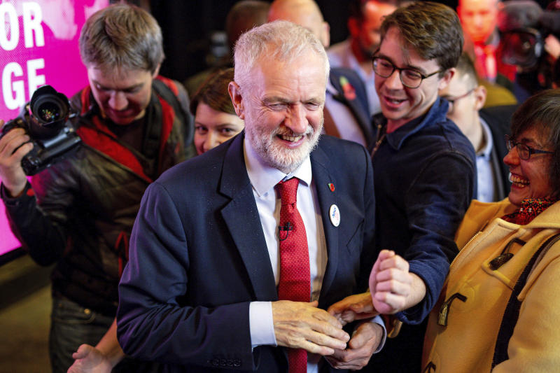 Britain's Labour Party leader Jeremy Corbyn speaks to supporters in Liverpool, England, Thursday Nov. 7, 2019. All 650 seats in the House of Commons are up for grabs in the Dec. 12 election, which is coming more than two years early. Some 46 million British voters are eligible to take part in the country's first December election in 96 years. (Jacob King/PA via AP)