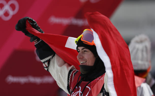 Canada's Sebastien Toutant celebrates winning the gold medal during the men's big air final.
