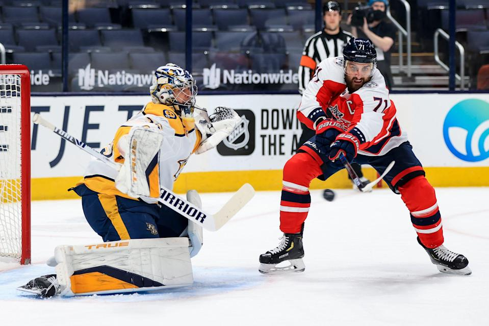 Feb 20, 2021; Columbus, Ohio, USA; Nashville Predators goaltender Pekka Rinne (35) reacts as Columbus Blue Jackets left wing Nick Foligno (71) deflects the puck in the air in the first period at Nationwide Arena.