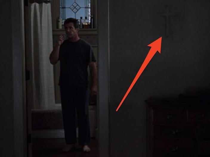 """A missing cross can be seen on the wall in """"Signs"""" while main character brushes teeth in the bathroom"""