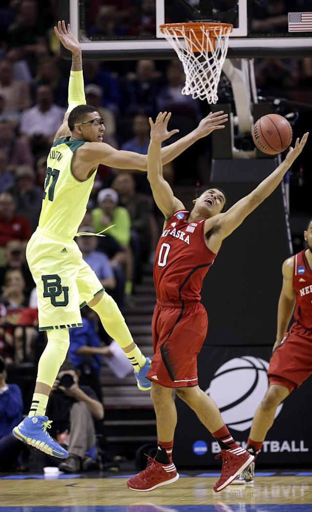 Baylor's Isaiah Austin (21) and Nebraska's Tai Webster (0) reach for a loose ball during the first half of a second-round game in the NCAA college basketball tournament Friday, March 21, 2014, in San Antonio. (AP Photo/David J. Phillip)