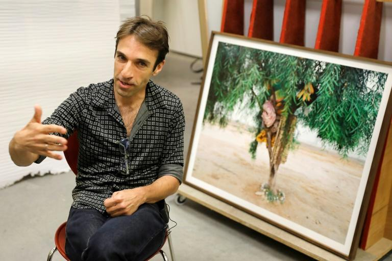 """Noam Gal, curator of photography at the Israel Museum, says Ron Amir's exhibition is also """"an opportunity to draw public attention to the phenomenon (of asylum seekers) from the artistic perspective"""""""