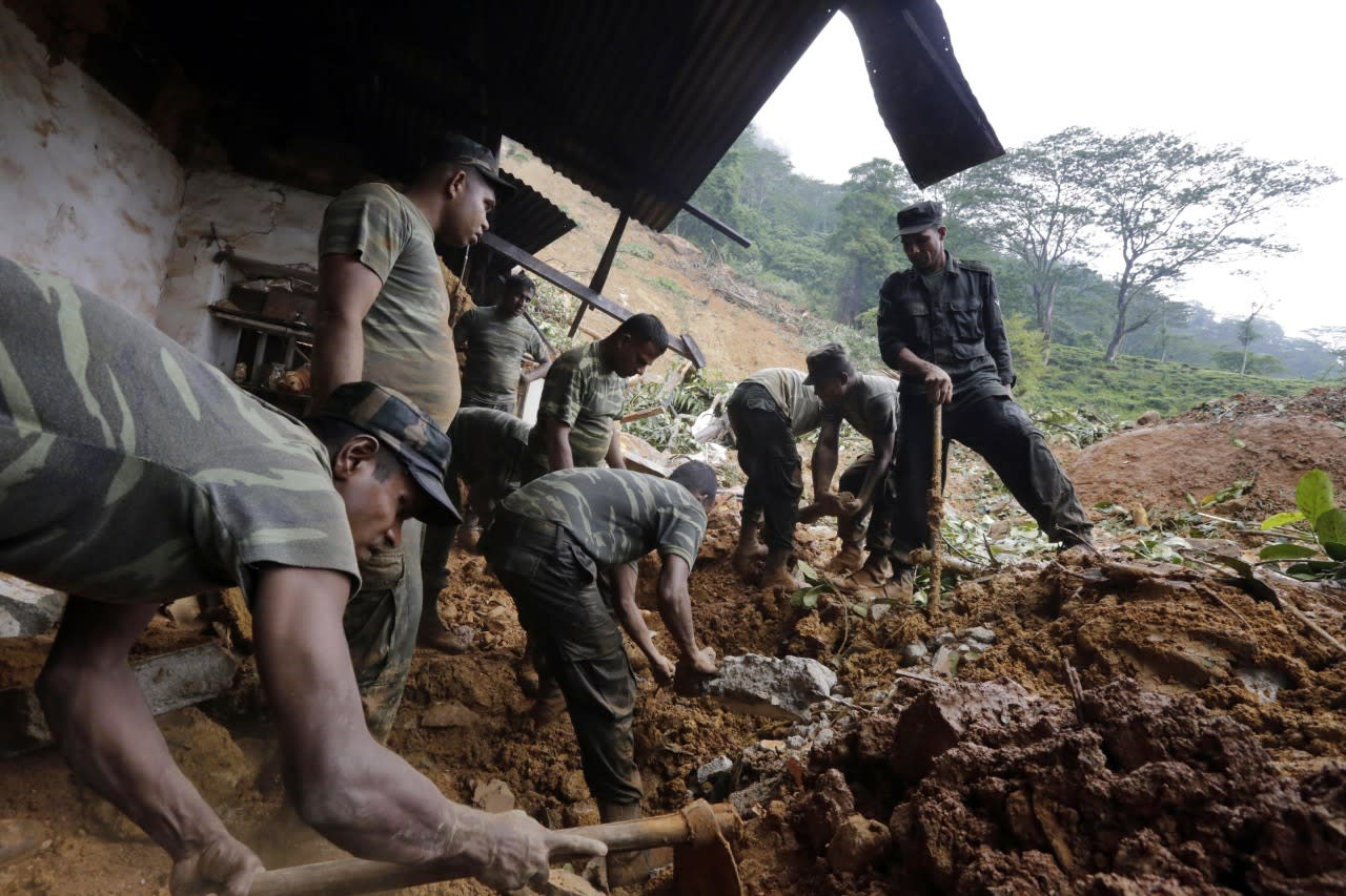 Sri Lankan armed forces engage in rescue operations at the landslide area where 16 persons had been reported missing at Kalupahanawatte in Bulathkohupitiya, Sri Lanka. By morning, rescuers had recovered two bodies. (M.A. Pushpa kumara/EPA)