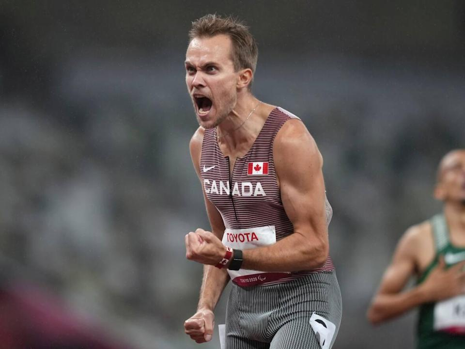 Canada's Nate Riech celebrates after winning the men's T38 1500m final at the 2020 Paralympic Games in Tokyo. (Emilio Morenatti/The Associated Press - image credit)