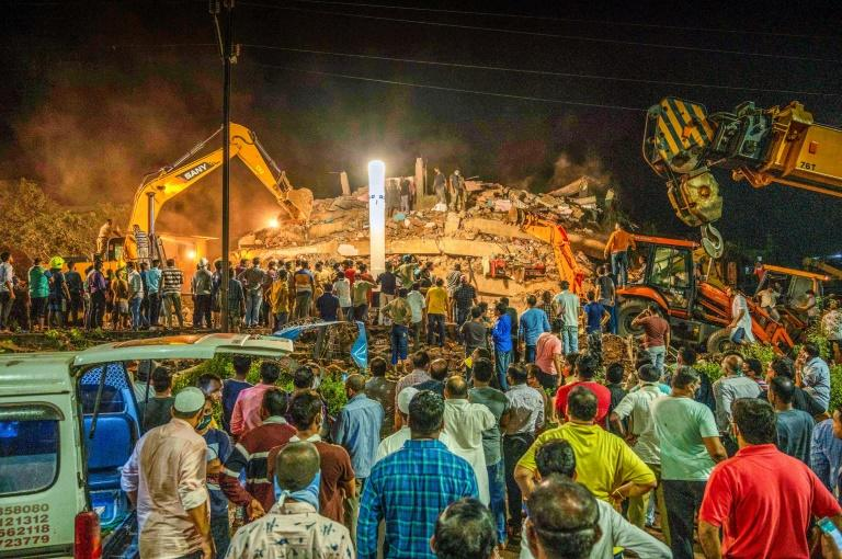 One dead, scores feared trapped in India building collapse