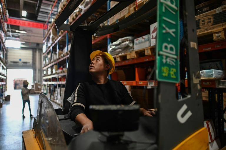 A forklift operator looks for products at a distrubition centre in Jiangsu province