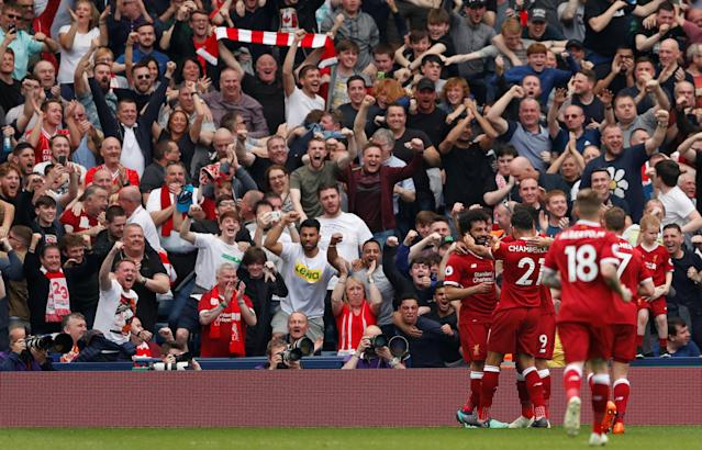 """Soccer Football - Premier League - West Bromwich Albion v Liverpool - The Hawthorns, West Bromwich, Britain - April 21, 2018 Liverpool's Mohamed Salah celebrates scoring their second goal with team mates Action Images via Reuters/Andrew Boyers EDITORIAL USE ONLY. No use with unauthorized audio, video, data, fixture lists, club/league logos or """"live"""" services. Online in-match use limited to 75 images, no video emulation. No use in betting, games or single club/league/player publications. Please contact your account representative for further details."""