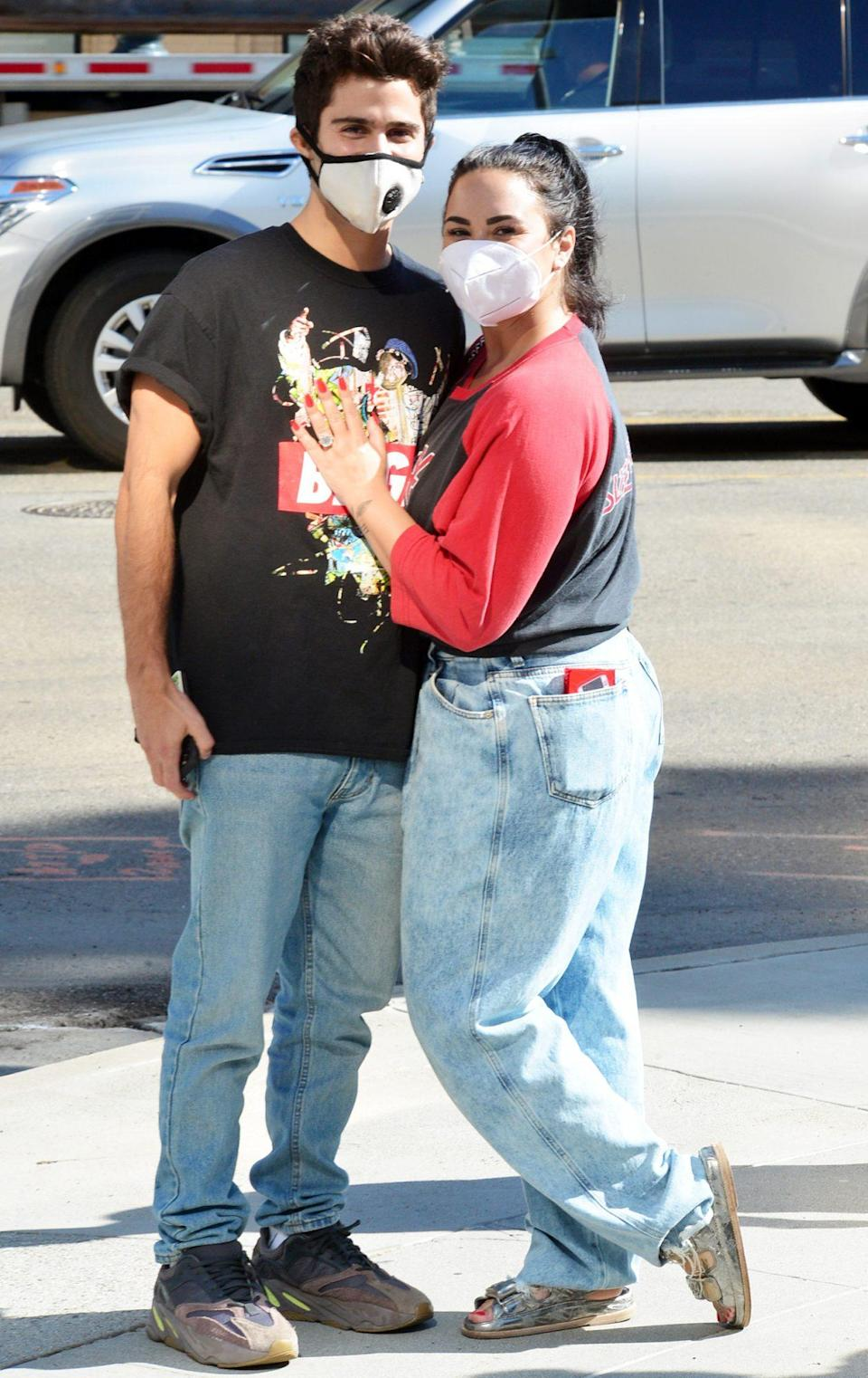<p>Newly engaged pair Demi Lovato and Max Ehrich cuddle up on Monday in Beverly Hills.</p>
