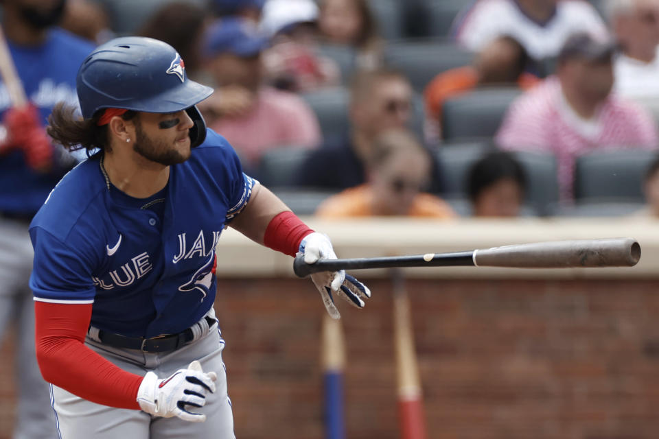 Toronto Blue Jays' Bo Bichette hits an two-RBI single in the sixth inning against the New York Mets during a baseball game Sunday, July 25, 2021, in New York. (AP Photo/Adam Hunger)