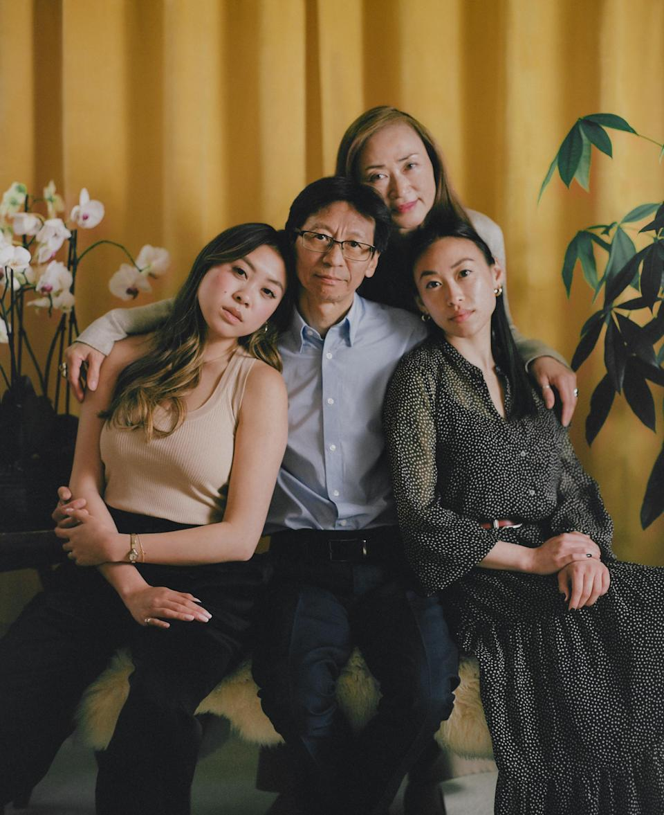 """<strong>'HE ISN'T A VICTIM.' </strong>Carl Chan, center, sits with his daughters Crystal Chan, right, and Emerald Chan, left, and his wife Eleanore Tang, above, at home in Alameda, Calif., on May 18. As president of the Oakland Chinatown Chamber of Commerce, Carl, 62, has long made the protection of local elders a priority in his work. When attacks against Asian Americans started increasing in 2020, he ramped up his efforts, handing out whistles and air horns to anyone on the street who would take them. """"We respect the elderly,"""" he says. """"To me, to us, to our community, it is the worst when they are attacking our seniors."""" Carl's daughters worried about their father's safety as he spent his time in areas where incidents of violence had taken place. """"What he's doing is so important,"""" Crystal, 28, remembers thinking. """"While there is a risk, we just can't keep thinking about that."""" On April 29, when Carl was on his way to visit an older Asian man who had been assaulted on a bus, he also fell victim to an unprovoked attack. He remembers hearing a man screaming and yelling a racial slur. Then he describes """"a quick punch to my head."""" Crystal said the emotions overwhelmed her quickly; first shock, then anger and sadness. She and her sister, who live across the country in New York, flew home as soon as they could. """"It's not easy for our family, especially [when] the ones close to you become the victim,"""" Eleanore says. """"It's so hard. It's so hard."""" But Carl, scraped and bruised, emerged from the attack even more determined. On May 15, he walked side by side with his daughters and wife in a """"Unity Against Hate"""" rally that he helped organize. """"While he was physically assaulted, he isn't a victim,"""" says Emerald, 24. """"He's showing that he's strong.""""<span class=""""copyright"""">Emanuel Hahn for TIME</span>"""