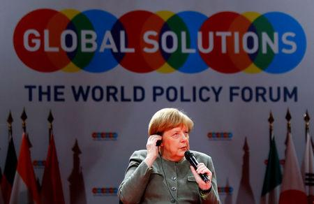 German Chancellor Angela Merkel takes part in a panel at the annual Global Solutions Summit in Berlin