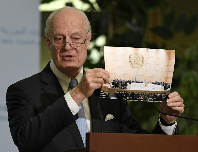 UN Special Envoy of the Secretary-General for Syria Staffan de Mistura shows a picture during a press conference as part of the Intra-Syrian peace talks at the European headquarters of the United Nations in Geneva, on March 3, 2017 (AFP Photo/PHILIPPE DESMAZES)