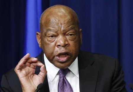 U.S. Representative John Lewis speaks before he helps unveiling the Harvey Milk Forever Stamp at its dedication ceremony at the White House in Washington May 22, 2014. The ceremony marks the first day of issue for the stamp honoring Milk. REUTERS/Larry Downing