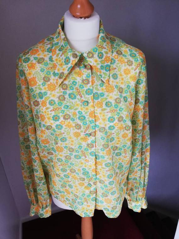 "I'm on the lookout for a blouse that feels comfy and casual but still dressed up enough for working from home, and I feel very passionate about this almost garishly patterned one. Designers in the '70s really knew how to throw a pattern together. I'd wear this with black cords on its own or with the cream sweater vest I'm planning on knitting. And I'd throw these clogs on for good measure...<br><br><strong>Butlerbizarrevintage</strong> Pretty 70s Floral Blouse, $, available at <a href=""https://www.etsy.com/uk/listing/865092915/pretty-70s-floral-blouse-in-fine-fabric?"" rel=""nofollow noopener"" target=""_blank"" data-ylk=""slk:Etsy"" class=""link rapid-noclick-resp"">Etsy</a>"