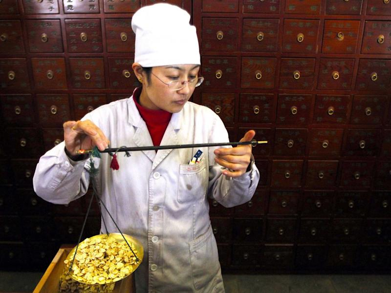 A worker weighs Chinese herbs as she prepares prescriptions at Beijing's Capital Medical University Traditional Chinese Medicine Hospital April 6, 2010. The hospital distributes around 20,000 doses of their herbal medicine daily, which amounts to more than five tonnes of ingredients. Traditional Chinese medicine practitioners are offering their treatments as an alternative to vaccinations after a series of health product safety scandals in China over the past few years. China's Health Ministry announced today an immediate investigation into bad vaccines that have been blamed for the deaths of four children in northern Shanxi province. China, often called the world's factory, is struggling to convince a sceptical domestic and global audience it has won a battle to improve safety standards. The world will mark World Health Day on April 7.