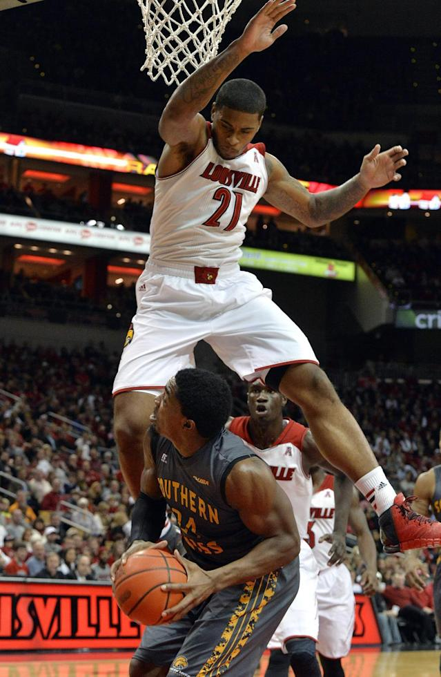 Louisville's Chane Behanan, top, goes up to block the shot of Southern Mississippi's Michael Craig during the first half of an NCAA college basketball game Friday, Nov. 29, 2013, in Louisville, Ky. (AP Photo/Timothy D. Easley)