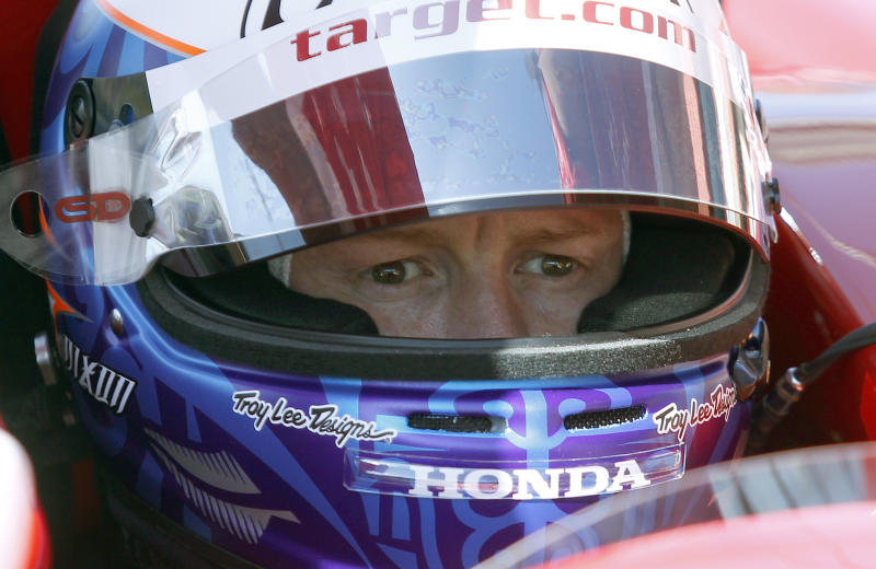 Driver Scott Dixon, of New Zealand, sits inside his car during a practice round for the IndyCar auto race at Auto Club Speedway, Friday, Oct. 18, 2013 in Fontana, Calif. (AP Photo/Alex Gallardo)
