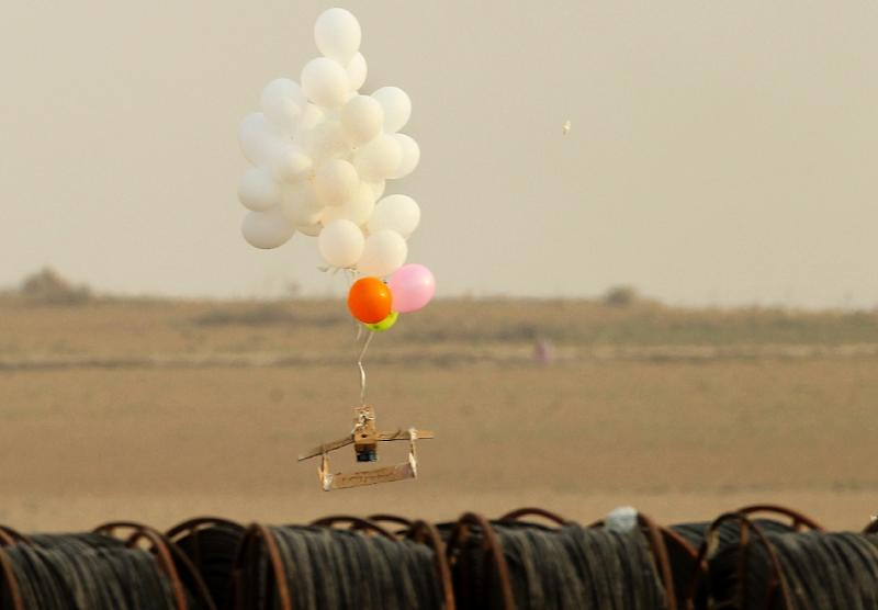 Palestinians have released incendiary devices tied to balloons during protests along the Gaza Strip's border with Israel