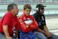 FILE - Mario Andretti, left, his grandson Marco, center, and son Michael are shown during the Toyota Indy 300 practice session at Homestead-Miami speedway in Homestead, Fla., in this Friday, March 24, 2006, file photo. Marco Andretti made the decision at the start of this year to step away from full-time racing and essentially end three generations of the most famous family in motorsports competing at the highest level. (AP Photo/Paul Kizzle, File)