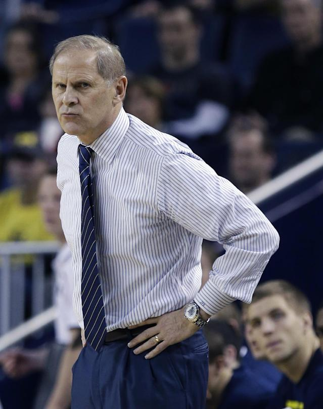 Michigan coach John Beilein looks from the sidelines during the first half of an NCAA college basketball game against Holy Cross in Ann Arbor, Mich., Saturday, Dec. 28, 2013. (AP Photo/Carlos Osorio)